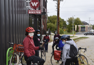 Children stand with bikes outside Wisconsin Bike Fed building.